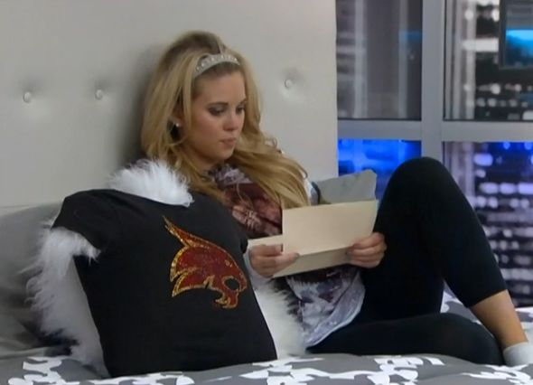 Aaryn reading her letter from home