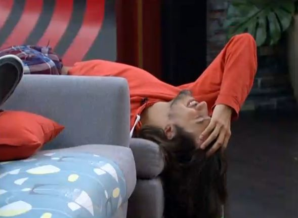 McCrae rolls around on the couch