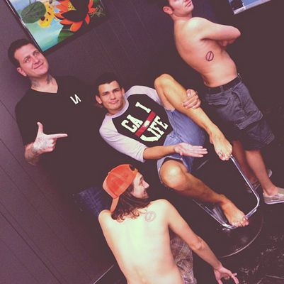 BB15 Guys pose with new tattoos