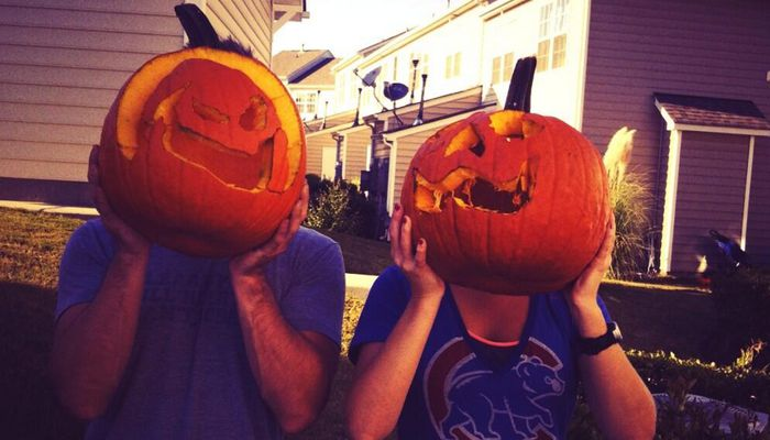 Jeff and Jordan carving pumpkins