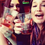 Kaitlin and Jessie celebrate with shots