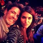 Amanda Zuckerman and Evel Dick watch Jessie wrestle