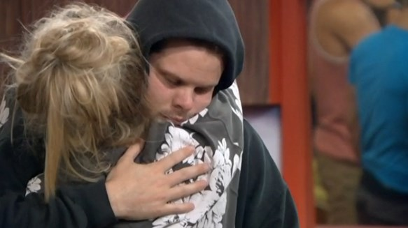Derrick hugs HGs after the news of his grandfather