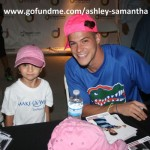 Zach Rance signs hats to support charity