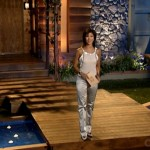 Julie Chen in front of the Big Brother 5 house