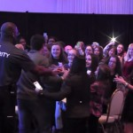 Security protects Cody from his screaming fans