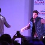 Zach and Cody dance around on stage