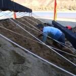 Jeff climbs through the dirt
