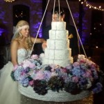 Aaryn cutting cake - Source: @GinaMarieZ