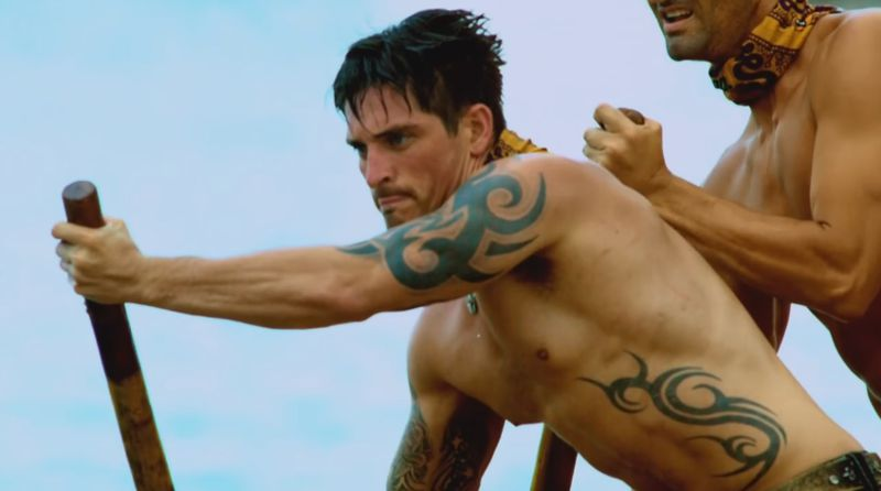 Caleb Reynolds intently paddles on Survivor