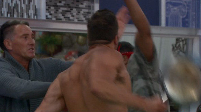 Mark wrestles pans from Josh's hands