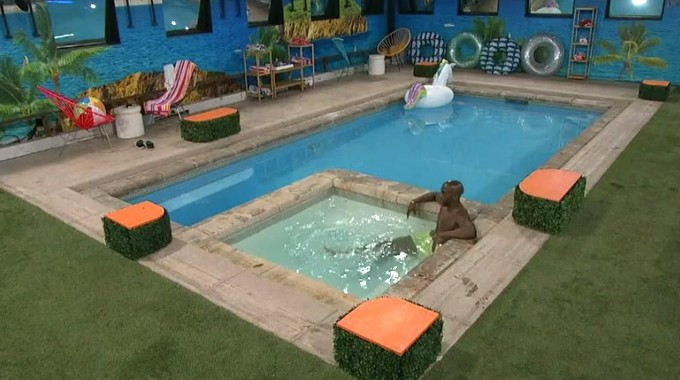Xavier alone in the Big Brother pool